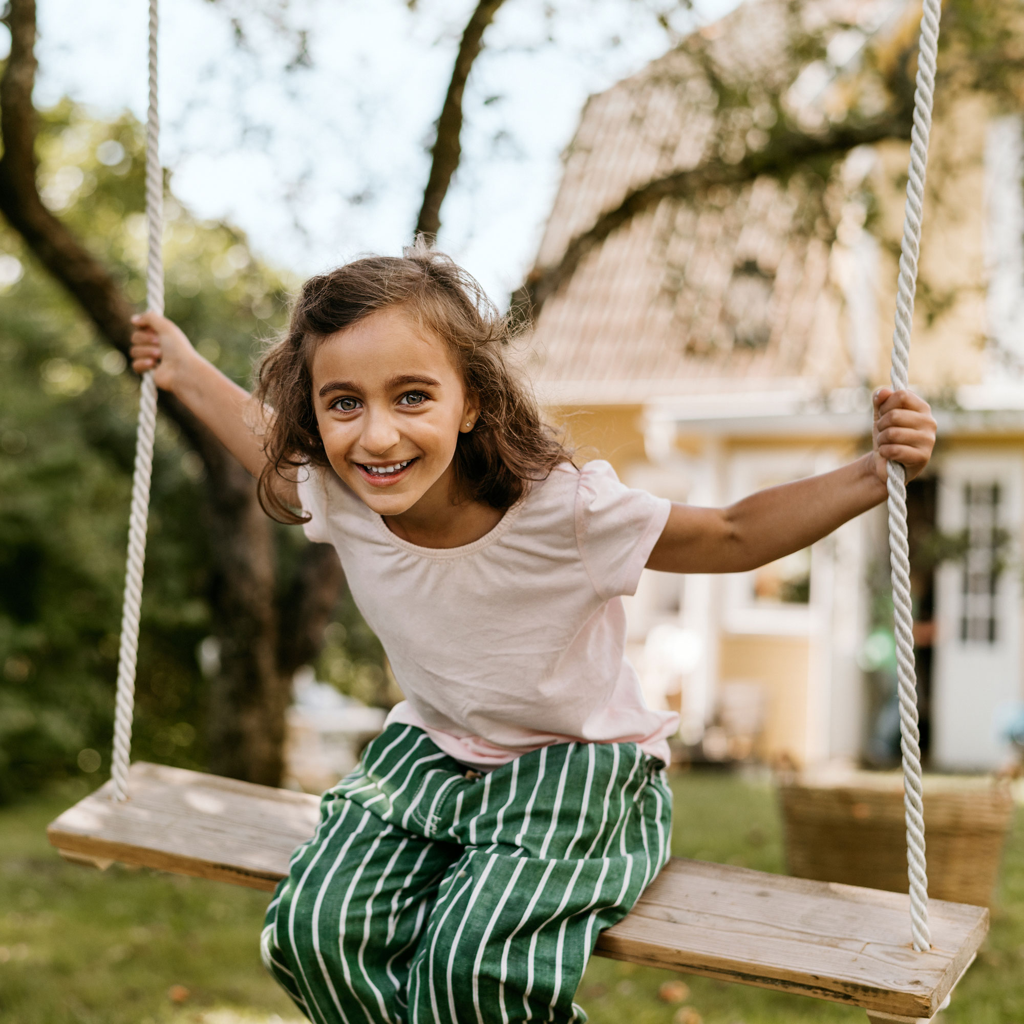 Girl sitting on a swing